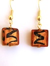 100% Murano Glass 12mm square earrings in amber coloured glass over 24kt gold leaf with a black squiggle on gold plated nickel free wires