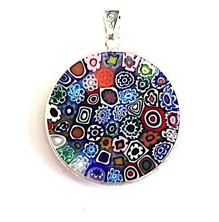 100% Murano Glass 26mm diameter Millefiore round pendant in the traditional style of multi coloured flowers surrounded by a silver bezel. This pendant is approx. 2mm in thickness and comes complete with a sterling silver snake chain measuring 45cm in length. As each pendant is unique there may be a slight variation in design. For that little bit extra the pendant is presented in an elegant RITZYROCKS black display box. PRICE -  65.00. Please note designs may vary.