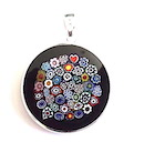 100% Genuine Murano Glass in the Millefiore style meaning 1000 flowers. This beautiful 26mm diameter pendant has a black edge with multi coloured miniature flowers within surrounded by a silver bezel. The pendant comes compelte with a 45cm sterling silver snake chain and is presented in an elegant black RITZYROCKS display box. PRICE - .00