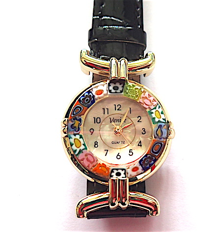 BACK IN STOCK - 100% Murano Watch with beautiful classic millefiore decoration around a gold bezel with a 15mm diameter watch face. This watch is on a lovely black leather band and has a quartz movement. Each watch has a guarantee and is presented in a nice box with a RITZYROCKS cleaning cloth. Please note that due to the handmade design there may be a slight variation in the flowers. PRICE -  55.00
