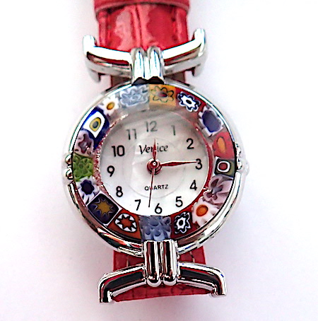 100% Murano Watch with beautiful classic millefiore decoration around a silver bezel with a 15mm diameter watch face. This watch is on a lovely red leather band and has a quartz movement. Please note that designs may vary ever so slightly. PRICE - $AUD 65.00