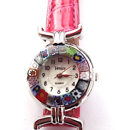 100% Murano Watch with beautiful classic millefiore decoration around a silver bezel with a 15mm diameter watch face. This watch is on a lovely pink leather band and has a quartz movement. Please note that designs may vary ever so slightly. PRICE -